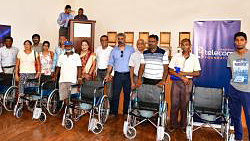 Donation of wheelchairs and school materials at Rivière du Rempart